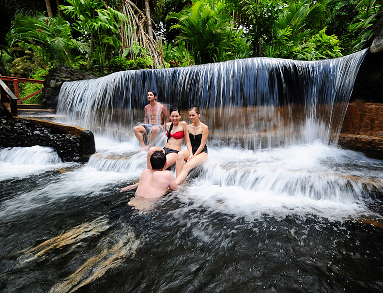Friends enjoying a small waterfall in Tabacon Arenal