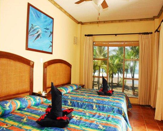 A beautiful hotel bedroom in Jaco