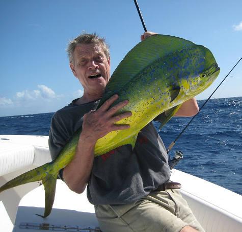 Man holding a big Mahi Mahi