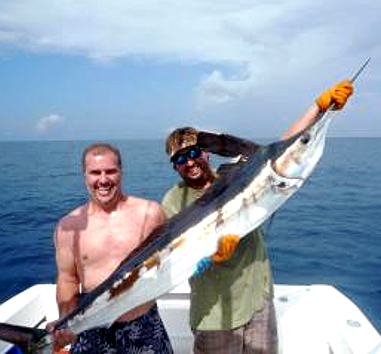 2 men holding a white marlin