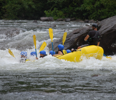 Group enjoying a whitewater rafting