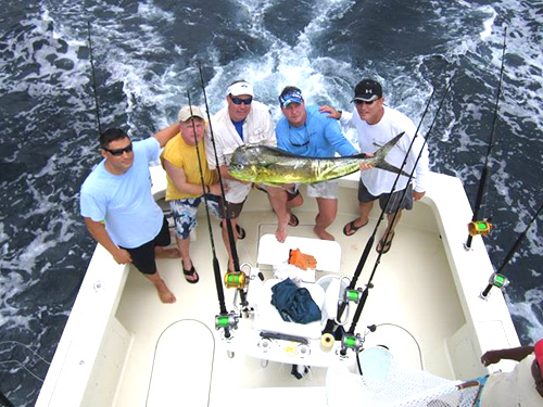 Group of fishermen holding a big fish