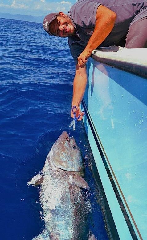 man catching giant tuna