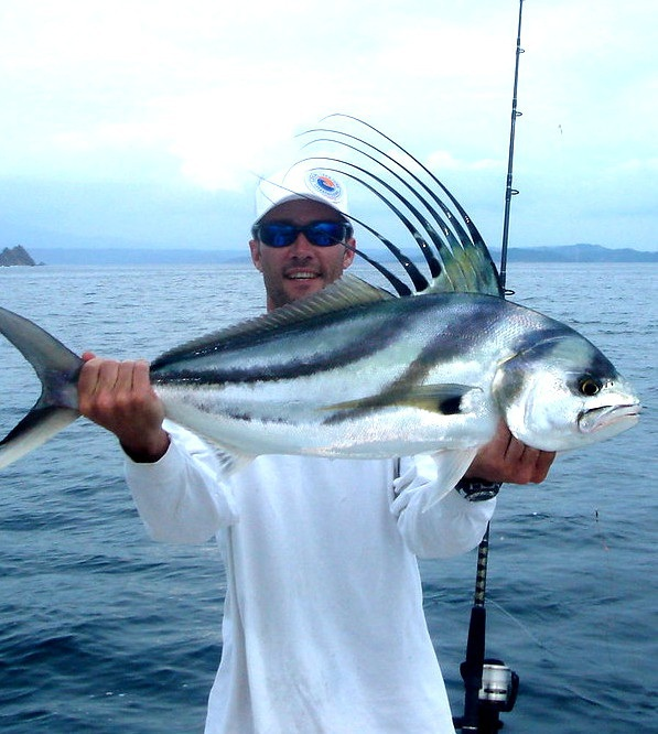 Man with a caught roosterfish