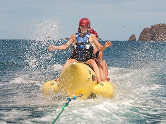 people on a banana boat ride off Tortuga Island in Costa Rica