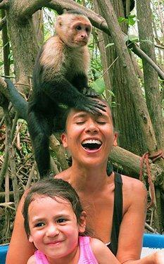 monkey on a woman's head on a tour in Costa Rica