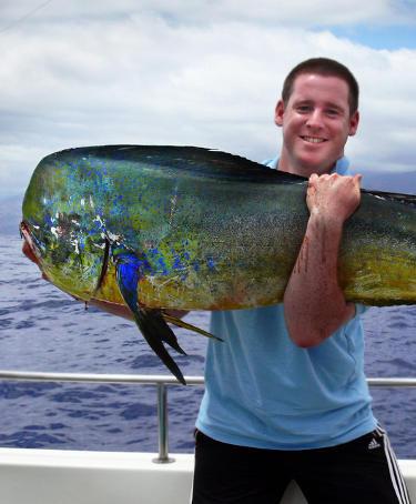 Man holding a Mahi-Mahi on a boat in Costa Rica