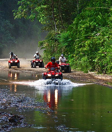 group on the riverbed on an ATV tour
