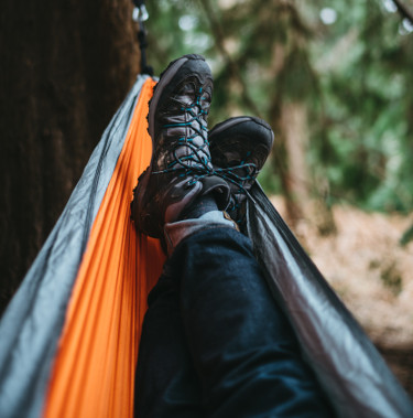 Someone wearing a hiking shoes in a hammock
