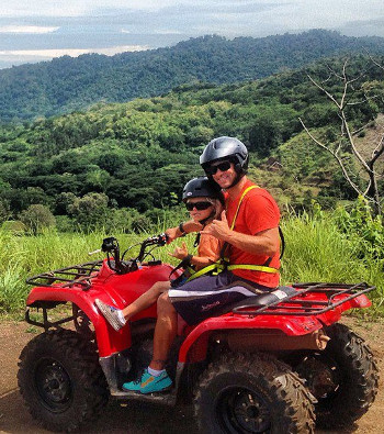 Dad and his child on ATV