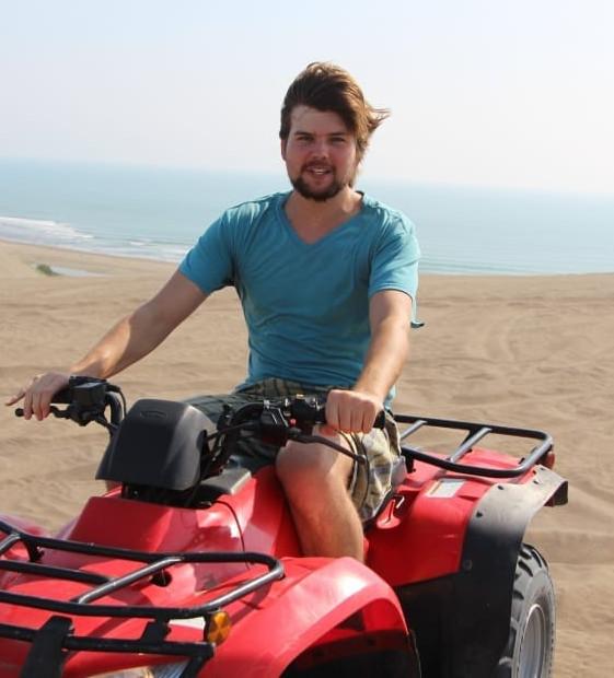 Man enjoying his ATV tour on a beach