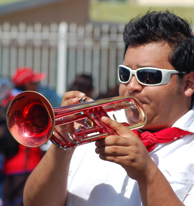 man playing trumpet in a Costa Rica parade