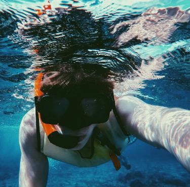 man snorkeling in Costa Rica