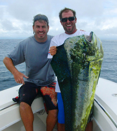 Two men holding a large yellowfin tuna