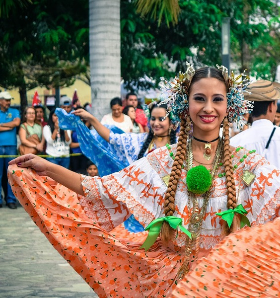 woman in a traditional Costa Rican costume in dance