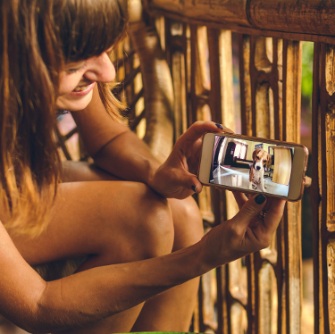 Woman showing something on her smartphone