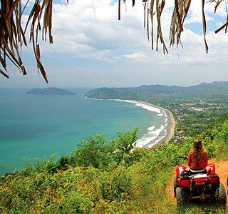 Woman ATV rider on bluff over jaco costa rica