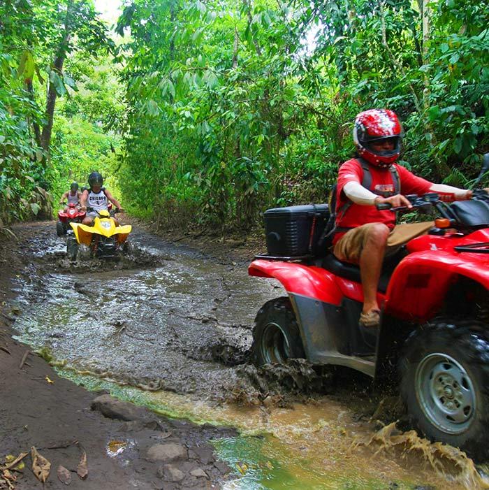 ATV riders taking a rainforest tour in Costa Rica