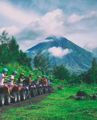 ATVs in front of volcano