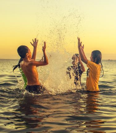 Children in the ocean in Costa Rica