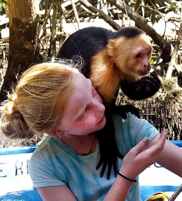 Girl in a monkey habitat in Costa Rica