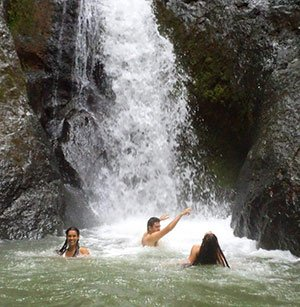 People having fun in a waterfall